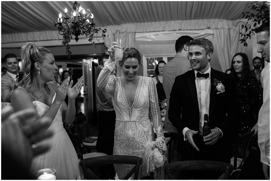Black and white photo of bride and groom sharing a toast with wedding guests during their wedding reception, DeLille Cellars wedding, Washington wedding planner, Perfectly Posh Events, Photo by Shane Macomber Photography