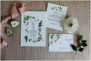 Close up of custom made wedding stationary on white paper featuring watercolor painting of pink peonies and greenery, PNW outdoor summer wedding, Washington wedding designer, Perfectly Posh Events, Photo by Kate Price Photography