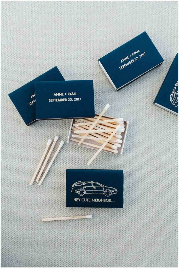 Close up of custom made matchbooks featuring a station wagon on a navy background, PNW outdoor summer wedding, Washington wedding designer, Perfectly Posh Events, Photo by Kate Price Photography