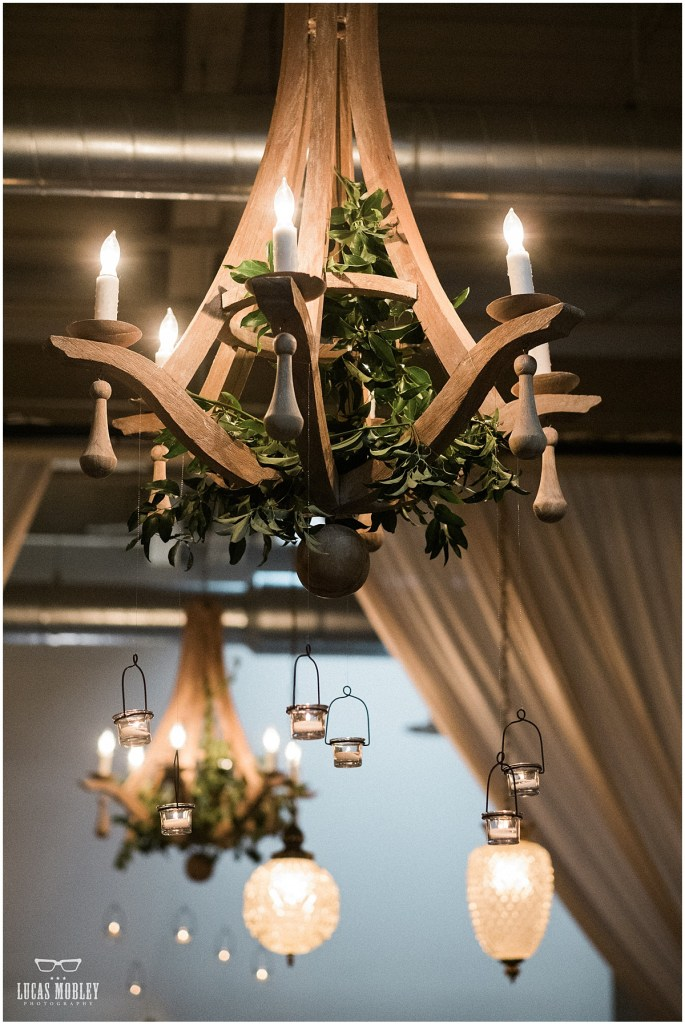 Wooden chandeliers draped in greenery with vintage glass lanterns, The Foundry by Herban Feast wedding, fall wedding, Seattle wedding planner, Perfectly Posh Events, Photo by Lucas Mobley Photography