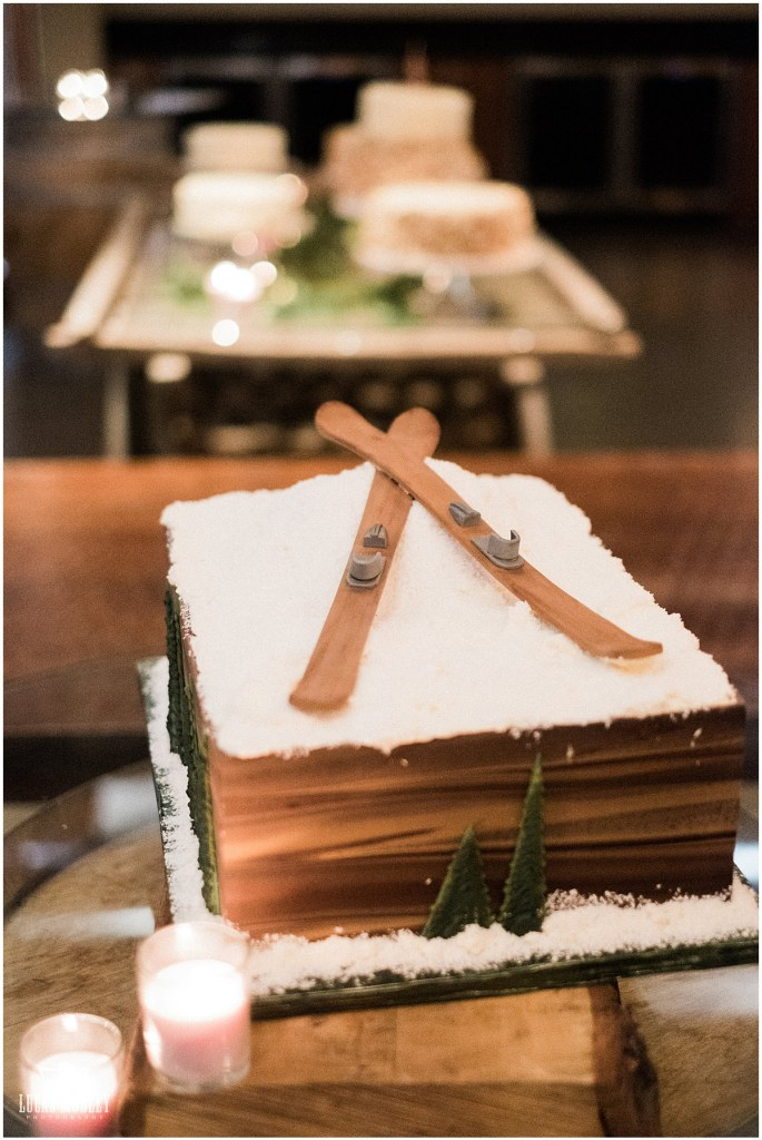 Custom designed grooms cake with a pair of skis sitting on a snowy frosting slope, The Foundry by Herban Feast wedding, fall wedding, Seattle wedding planner, Perfectly Posh Events, Photo by Lucas Mobley Photography