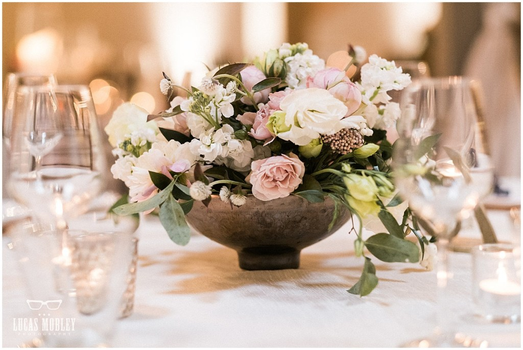 Wedding reception dinner table centerpiece in a large stone vase with ivory and blush florals with pops of greenery, The Foundry by Herban Feast wedding, fall wedding, Seattle wedding planner, Perfectly Posh Events, Photo by Lucas Mobley Photography