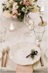 Wedding reception dinner place setting with a custom designed menu sitting on a white plate with rose gold cutlery and an ivory and blush floral centerpiece, The Foundry by Herban Feast wedding, fall wedding, Seattle wedding planner, Perfectly Posh Events, Photo by Lucas Mobley Photography