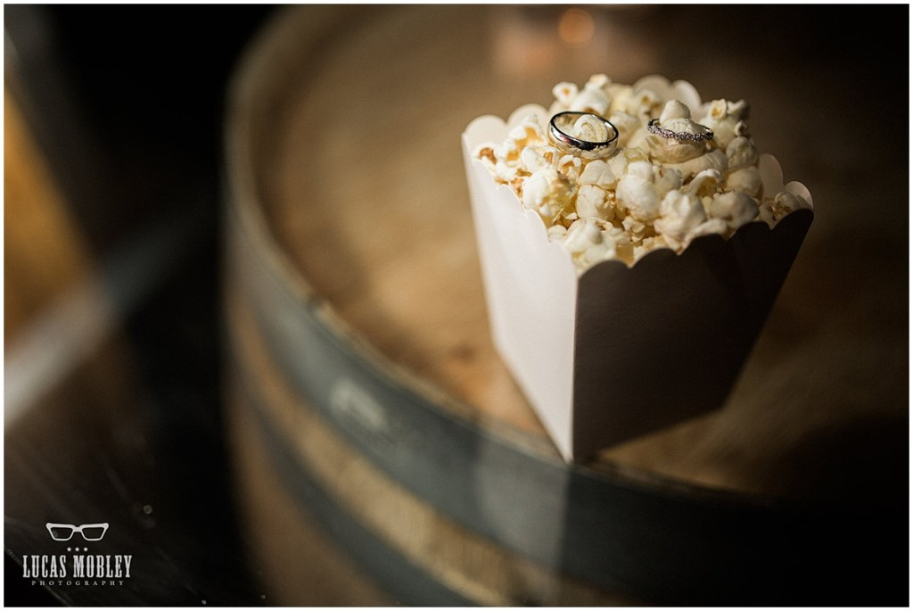 Close up of bride and groom's wedding bands sitting atop a bed of popcorn on a wine barrel, The Foundry by Herban Feast wedding, fall wedding, Seattle wedding planner, Perfectly Posh Events, Photo by Lucas Mobley Photography