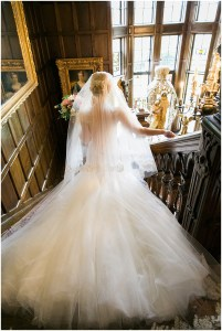 Bride walks downstairs wearing an off white ballgown featuring a dramatic tulle train, Pacific Northwest wedding, Thornewood Castle wedding, wedding planning by Perfectly Posh Events, Photo by Stephanie Cristalli