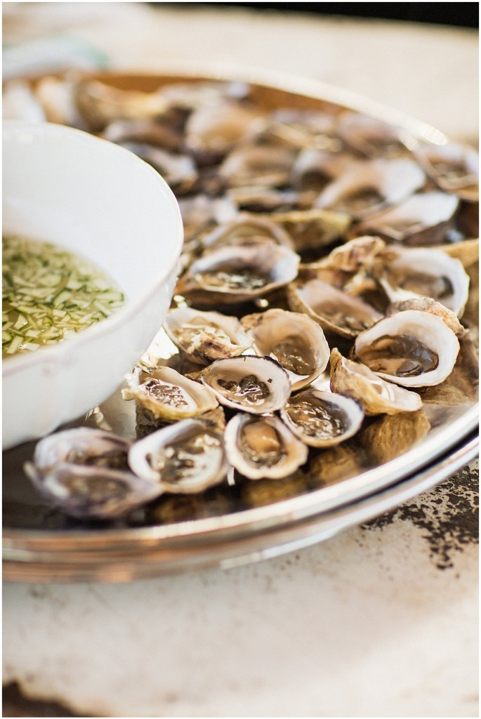 A silver tray full of oyster shooters with a dipping sauce, urban wedding, Within Sodo wedding, Seattle event planner, Perfectly Posh Events, Photo by Jenny J Photography