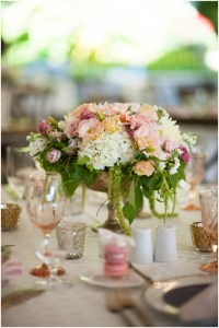 Wedding table centerpiece with a large bouquet of ivory, peach, and pink colored flowers with plenty of greenery in a gold urn, DeLille Cellars wedding, Woodinville winery, Washington wedding, Perfectly Posh Events wedding planning, Photo by Barbie Hull