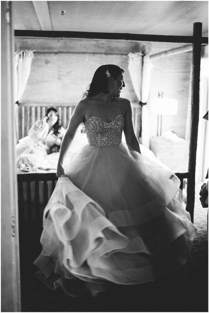 Black and white photo of bride getting ready for her wedding in an off-white strapless wedding gown with a beaded bodice and tulle skirt, Edgewater Hotel, Seattle wedding, Washington wedding coordinator, Perfectly Posh Events, Photo by Carina Skrobecki