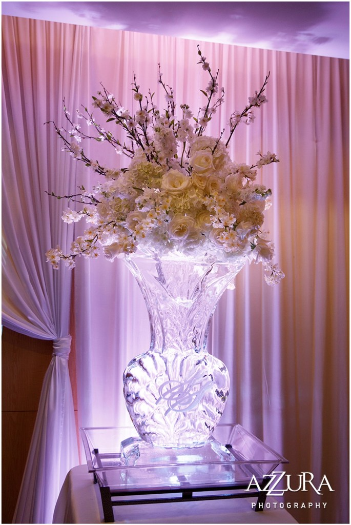 Custom made ice sculpture featuring the bride and groom's initials serves as an oversized vase for a large white and ivory floral bouquet, Four Seasons wedding, Seattle wedding, Perfectly Posh Events event coordination, Photo by Azzura Photography