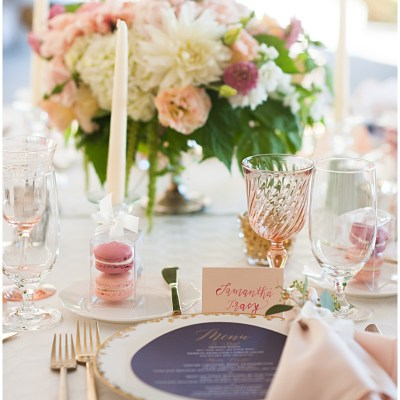 Blush and navy place setting with macaron wedding favors, taper candles, and romantic flower centerpiece | Whimsical and Romantic Wedding at DeLille Cellars | Wedding Planning & Design by Perfectly Posh Events | Wedding Photos by Barbie Hull Photography | Wedding Flowers by Floressence | #perfectlyposhevents