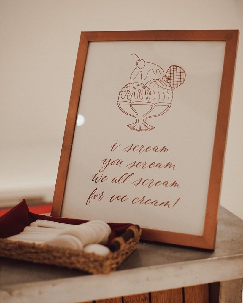 "Customized wedding signage featuring the classic ""I scream, you scream, we all scream for ice cream"" saying."