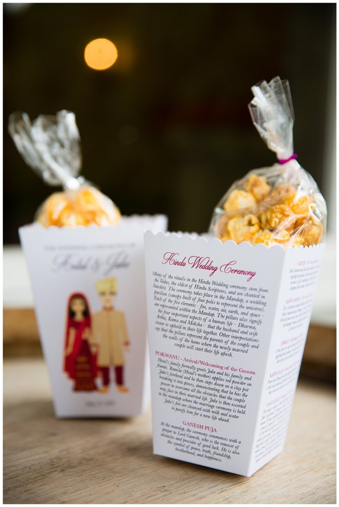 Hetal + Jake wanted their guests to be able to follow along with their ceremony so they created these cute popcorn boxes that spelled out the ceremony. And guests snacked on the sweet treat.