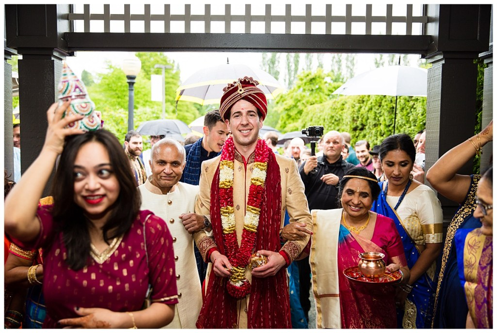 After the receiving ceremony is complete, Hetal's family leads him into the wedding ceremony followed by Hetal + Jake's wedding guests.