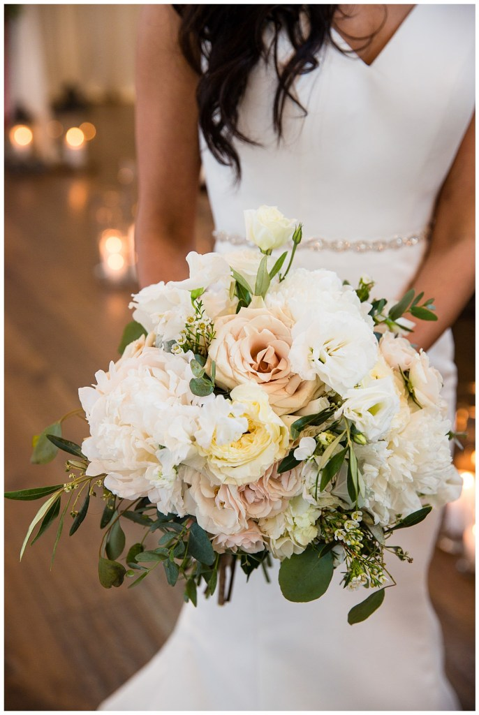 Hetal's bouquet featured a color palette of romantic blush, cream and white florals.