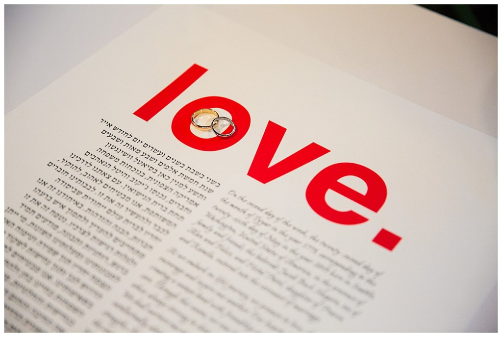 "Hetal + Jake's ketubah, a Jewish wedding contract, featured the word ""love"" in a bold and vibrant red."