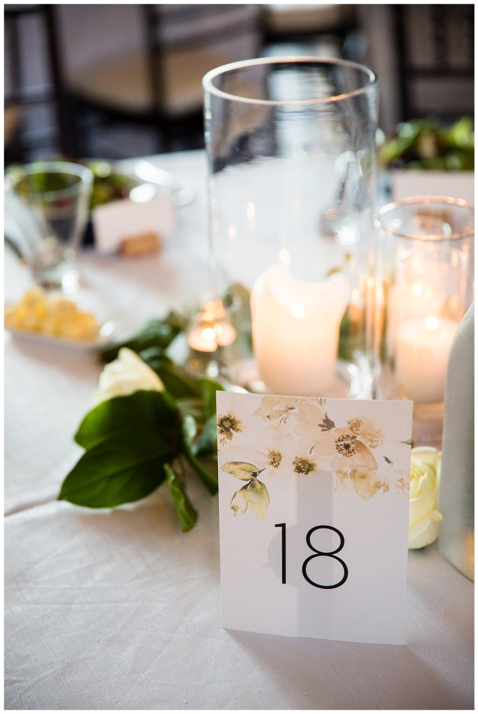 Hetal + Jake's florals featured a color palette of romantic blush, cream and white and helped set a cohesive tone with their reception table numbers.