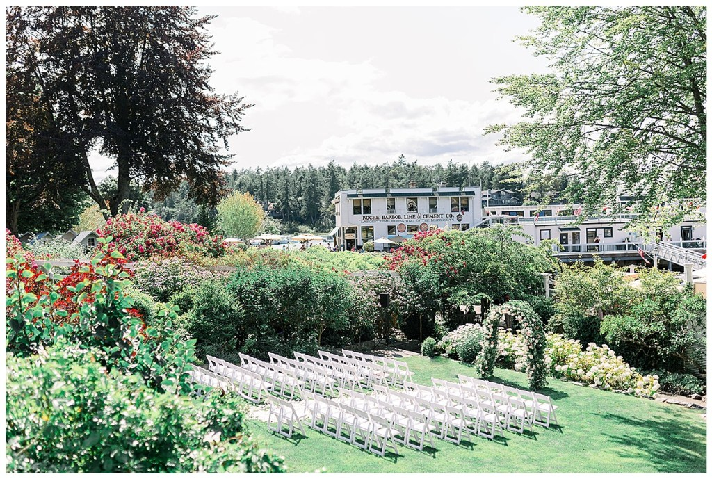 White wedding ceremony chairs and ceremony arch at Roche Harbor Resort, WA.
