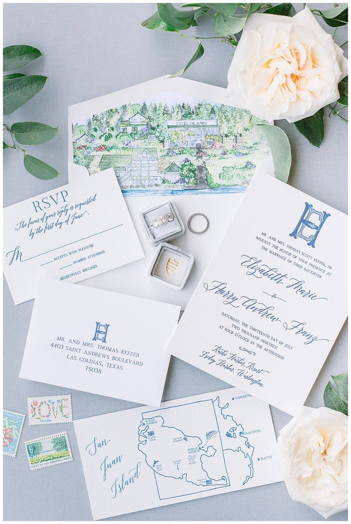 Blue wedding invitation suite with custom venue illustration, map of the San Juan Islands and a monogram.