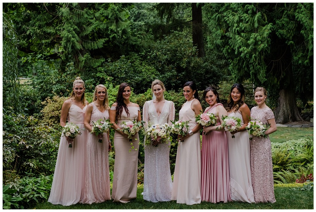 Blush bridesmaids dresses in different styles with white and blush flower bouquets. Click for more PNW design from this Chateau Lill wedding in Woodinville, WA. Wedding planning by Perfectly Posh Events, based in Seattle. Wedding photography by Shane Macomber Photography. Wedding Flowers by Flora Nova Design. Wedding Dress by Inbal Dror #perfectlyposhevents