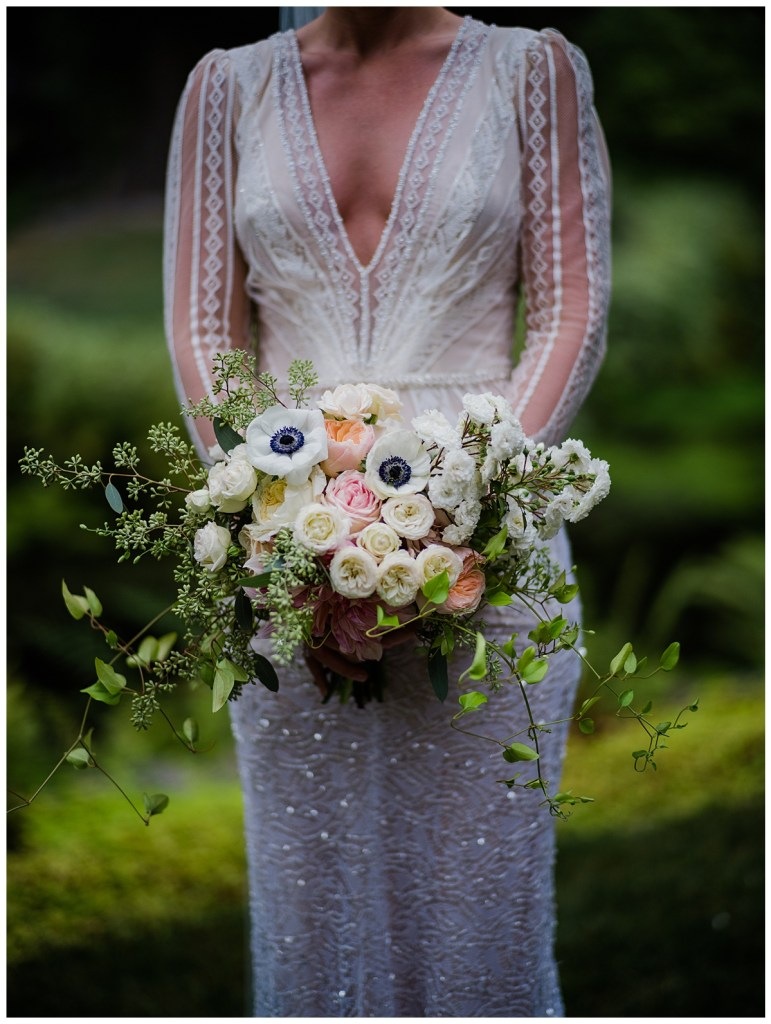 Bride in Inbal Dror wedding gown holding a lush, white and blush bridal bouquet with trailing vines. Click for more lush and luxurious design from this Chateau Lill wedding in Woodinville, WA. Wedding planning by Perfectly Posh Events, based in Seattle. Wedding photography by Shane Macomber Photography. Wedding Flowers by Flora Nova Design. #perfectlyposhevents