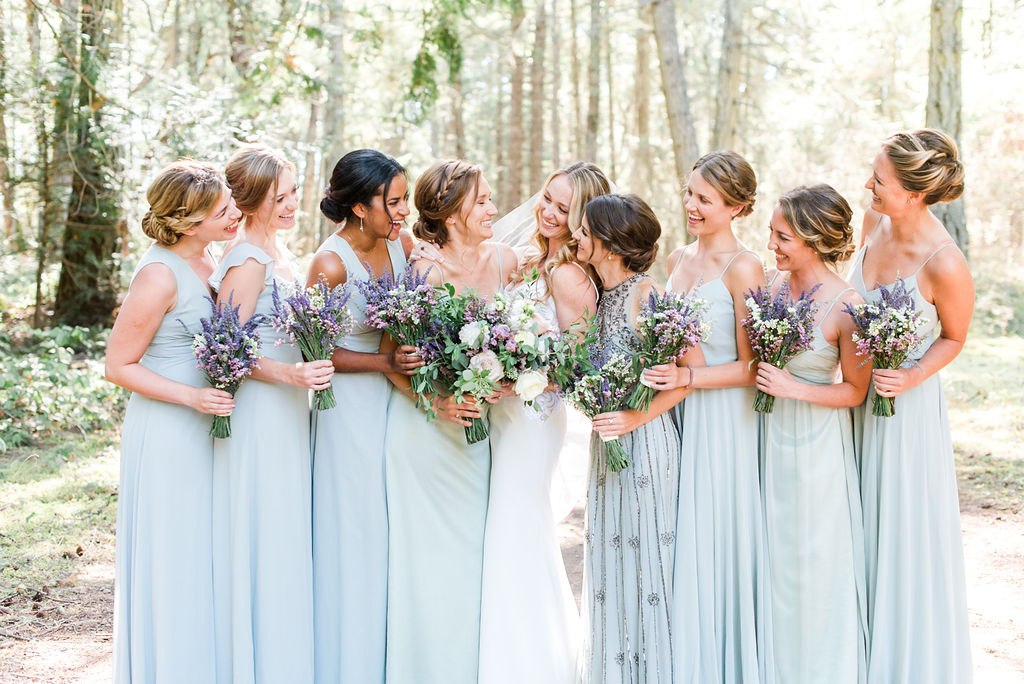 Pale blue and green bridesmaids dresses with pastel flower bouquets. Click for more neutral and pastel chic wedding design from this San Juan Island wedding at Roche Harbor Resort in San Juan Island, WA. Wedding planning by Perfectly Posh Events, based in Seattle and Portland. Wedding photography by Lloyd Photographers. Flowers by Bloom San Juan. Dress by Hayley Paige #perfectlyposhevents