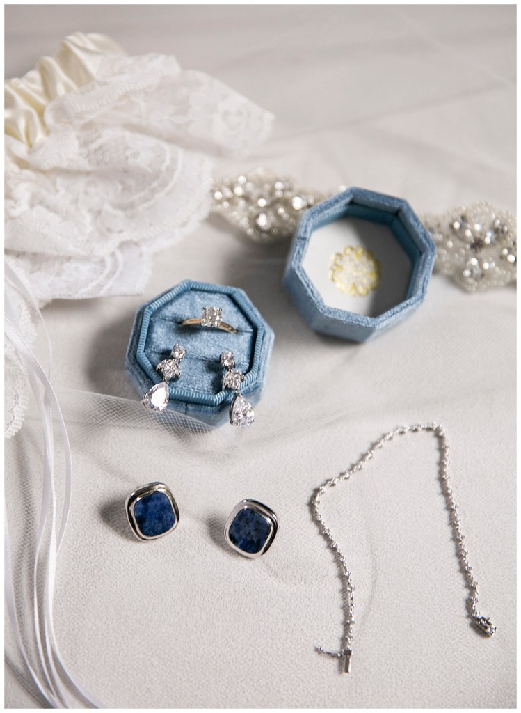 Blue wedding ring box and blue earrings for bride's wedding jewelry at a Catholic church wedding ceremony in Seattle, WA.