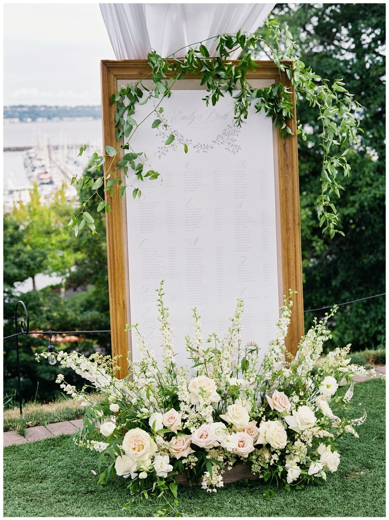 Admiral\'s House wedding with large linen board escort sign for table assignments. Click for more from this Timeless Coastal Wedding at The Admiral\\\'s House in Seattle, WA. Wedding planning by Perfectly Posh Events, based in Seattle and Portland. Wedding photography by Amanda K Photography. Floral Design + Giant Linen Board Rental by Kaleb Norman James Design. Printed Escort Sign by Grey & Cake. #perfectlyposhevents