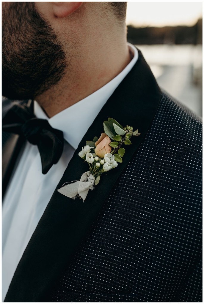 Boho groom boutonniere with small flowers and greenery tied with raw ribbon in wedding at Alderbrook Resort & Spa, WA.
