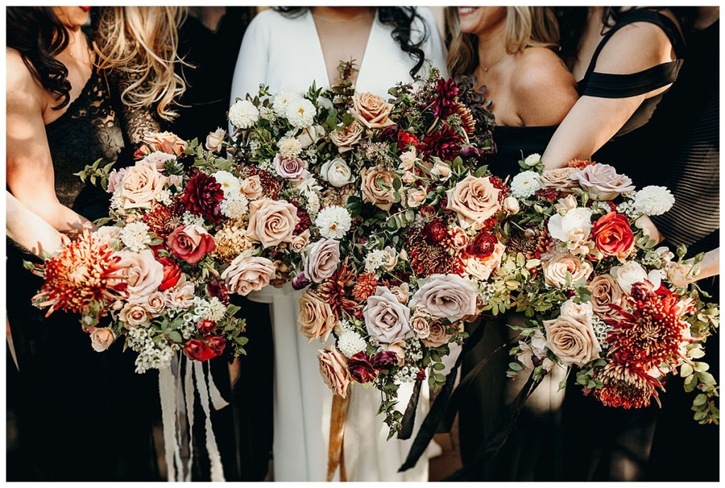 Boho bridal bouquet and bridesmaid bouquets with dark, dramatic and moody florals with a loose and wild feel and trailing ribbon at Alderbrook Resort & Spa, WA.