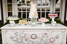 Robinswood House Wedding in Bellevue   Rustic dessert table with whimsical decor   Perfectly Posh Events, Seattle Wedding Planner   Courtney Bowlden Photography   Midori Bakery   Shabby chic dessert display with wedding cake, parfaits, and macarons