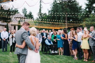 Bride and groom at private estate wedding in woodinville with bistro lights, Allison Dan Woodinville Wedding by Perfectly Posh Events, Photo by Blue Rose Photography