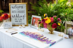 Kiana Lodge Wedding on Bainbridge Island, WA | Colorful city skyline painting as creative guest book alternative | Perfectly Posh Events, Seattle Wedding Planning | Shane Macomber Photography | Calligraphy Design by Whit Design Shop | Floral Design by Flora Nova
