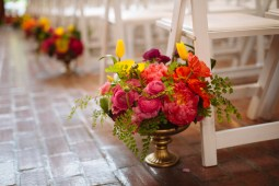 Kiana Lodge Wedding on Bainbridge Island, WA | Vibrantly colored, loosely arranged ceremony arrangements with pink, orange, and yellow blooms | Perfectly Posh Events, Seattle Wedding Planning | Shane Macomber Photography | Floral Design by Flora Nova