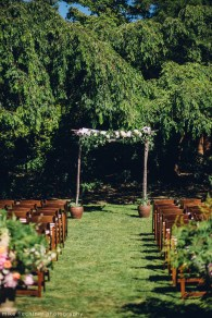 Parsons Gardens Wedding in Seattle | Parsons Gardens ceremony with wooden chuppah and greenery installation | Perfectly Posh Events, Seattle Wedding Planner | Mike Fiechtner Photography | Floral Design by The London Plane