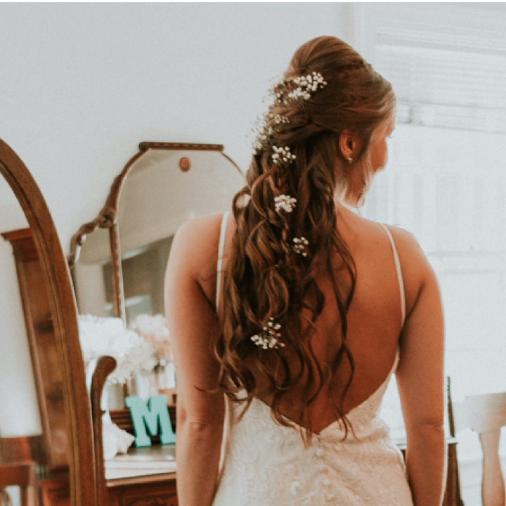 Our work: bride with braided and curled hair with flowers