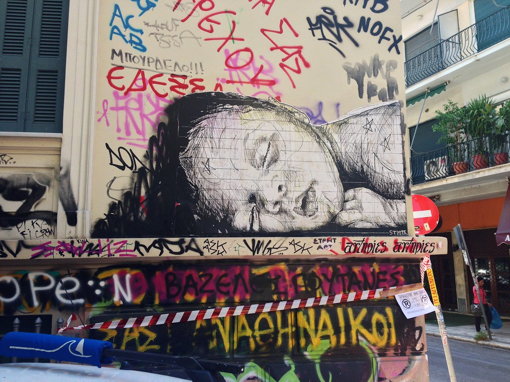 Street art of a sleeping homeless immigrant girl, Exarchia, Athens, Greece