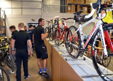 NetApp team members checking out ASI bikes in the warehouse
