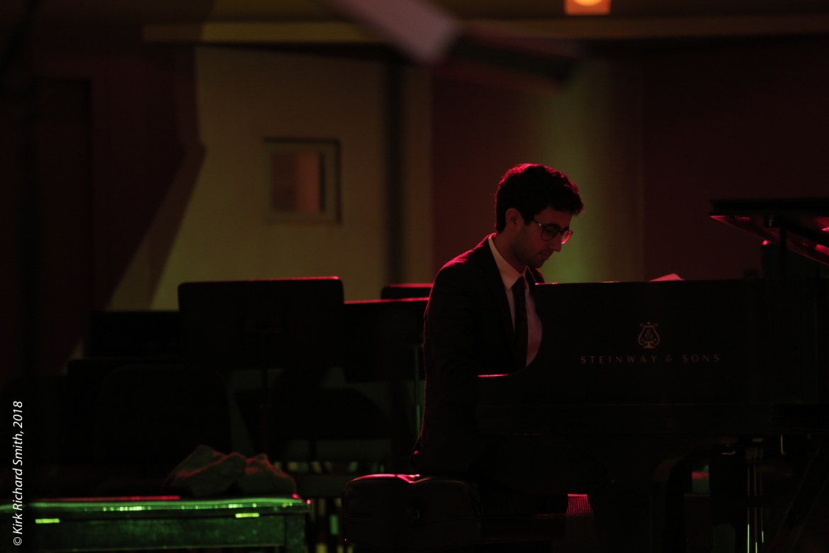 Alex Mansour playing piano