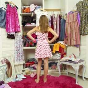 woman-standing-in-front-of-closet-tq