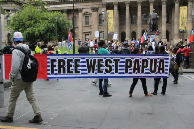 Free West Papua protesters gather at the Victorian State Library, photo Jarni Blakkarly