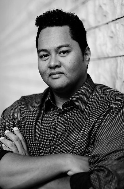 black and white image of Faizal Abdullah from Hatch Theatrics