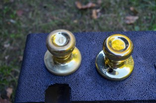 sanded knob vs shiny contractor brass knob
