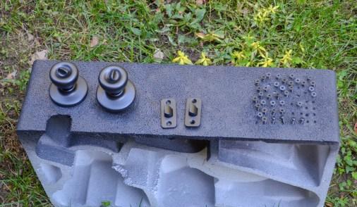 styrofoam holding hardware in place