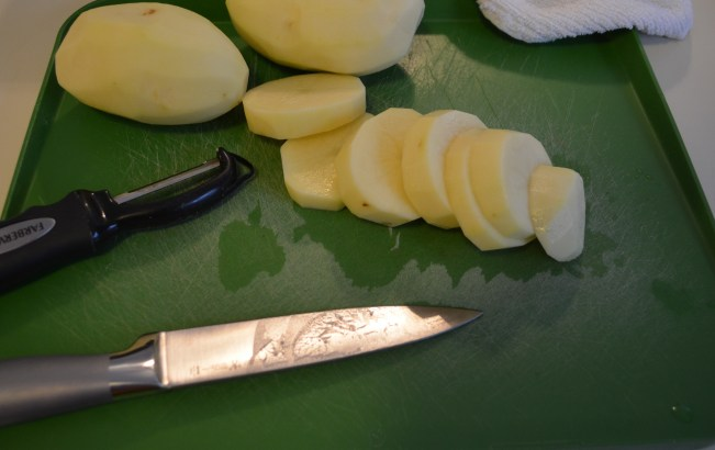 cutting up potatoes