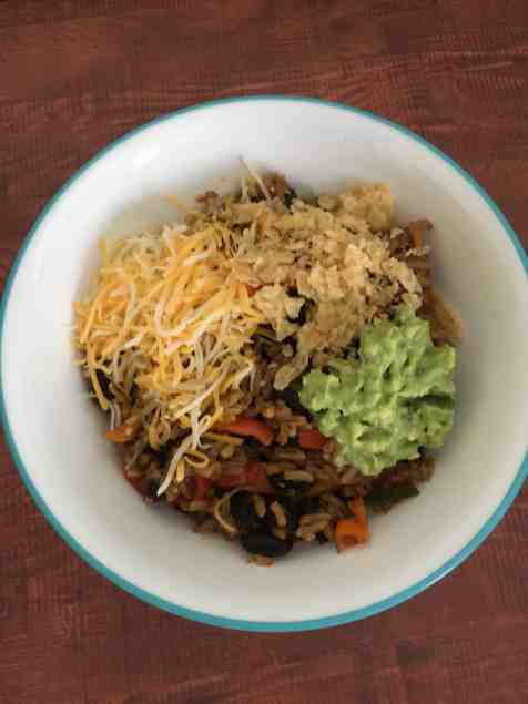 black bean and rice bowl with toppings