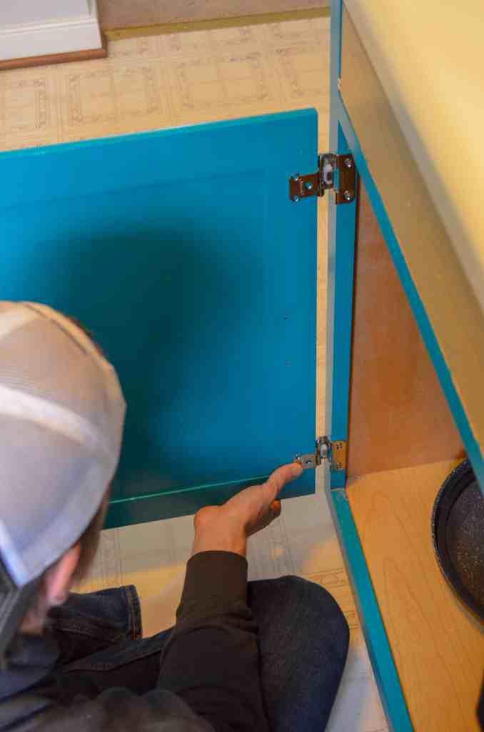 lining up doors to mark hinge holes