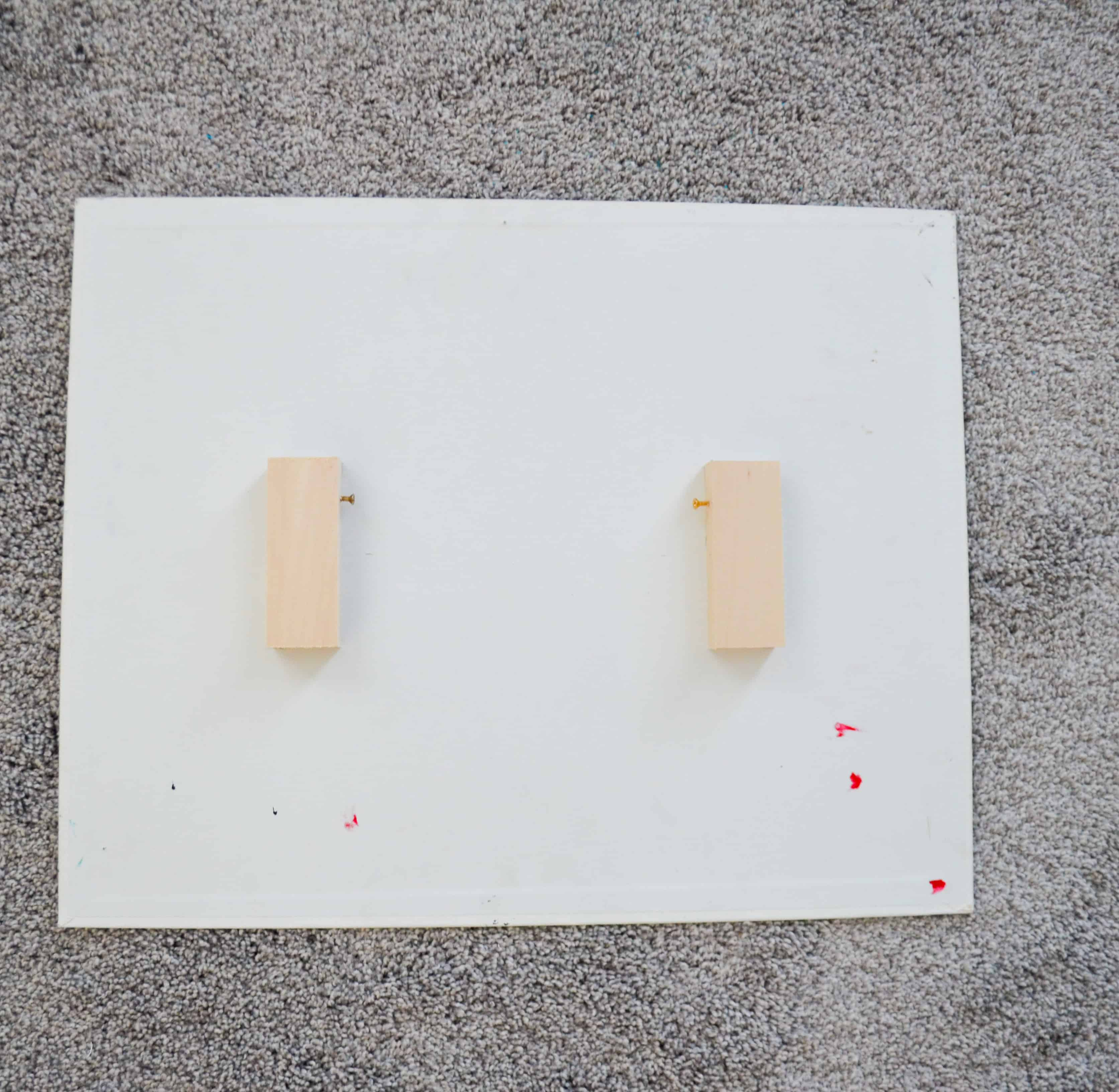 Hang A Canvas: measure and glue blocks to the back of the painting