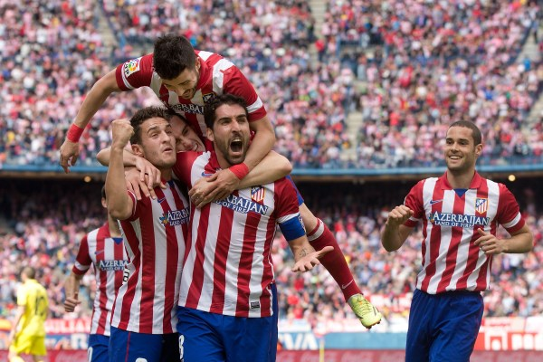 Atletico de Madrid teammates celebrate a goal scored by Raul Garcia (second from right) during the La Liga match between Club Atletico de Madrid and Villarreal CF at Vicente Calderon Stadium in Madrid, Spain.  (Gonzalo Arroyo Moreno/Getty Images)