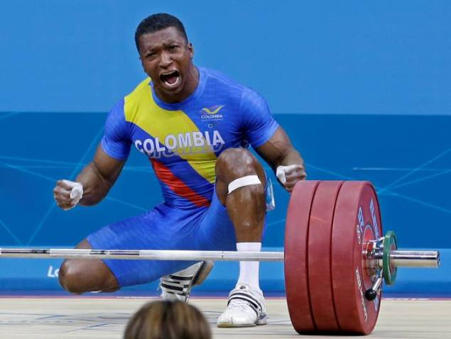 Oscar Albeiro Figueroa Mosquera of Colombia competes during the men's 62-kg, group A, weightlifting competition at the 2012 Summer Olympics, Monday, July 30, 2012, in London. Mosquera won the silver medal. (AP Photo/Hassan Ammar)