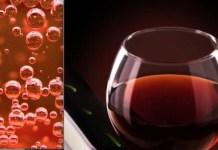 Burbujas de espumoso rosado y copa de vino tinto